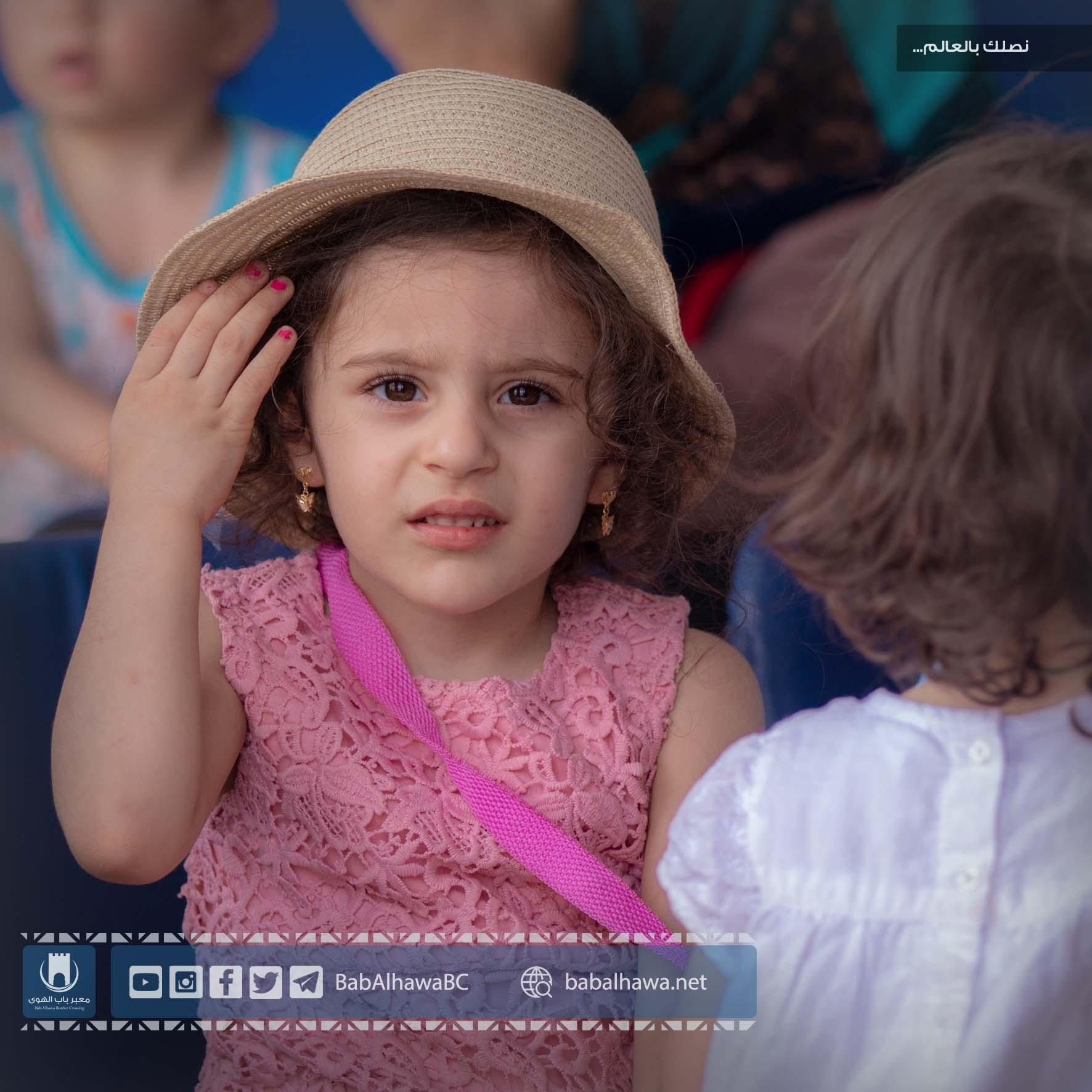 طفلة مسافرة في زيارة عيد الفطر عبر معبر باب الهوى 2019